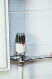 Close up of handyman repairing radiator Stock Image