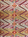 Close up of a hanged colourful handmade traditional wool rug royalty free stock photography
