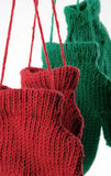 Close Up Hanging Mittens. Detail of red and green mittens hanging from a line royalty free stock image