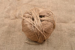 Close up of hank of twine, reel of rope, ball of hemp thread on Royalty Free Stock Images