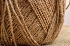 Close up of hank of twine, reel of rope, ball of hemp thread on Royalty Free Stock Photo