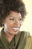 Close-up of a happy African American woman looking away over colored background Royalty Free Stock Images