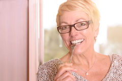 Close up Happy Blond Woman Biting a Fork Royalty Free Stock Photography