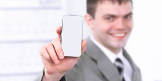 Close up.happy businessman showing a mobile phone stock photography