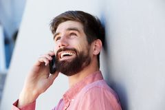 Close up happy businessman talking on mobile phone Stock Image