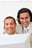 Close-up of happy businessmen working together Royalty Free Stock Image