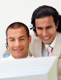 Close-up of happy businessmen working together Royalty Free Stock Photos