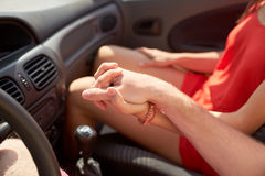 Close up of happy couple driving in cabriolet car Stock Images