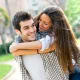 Close up of happy couple piggybacking. Stock Photo