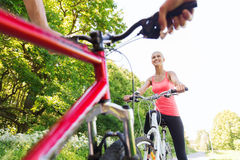 Close up of happy couple riding bicycle outdoors Stock Photos