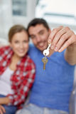 Close up of happy couple showing key at home Stock Photos