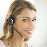 Close-Up Of Happy Customer Service Representative. Close-up portrait of happy female customer service representative wearing headset Royalty Free Stock Image