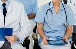 Close up of happy doctors at seminar or hospital Royalty Free Stock Image
