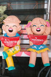 Close up,Happy dolls for garden decoration havegreeting in Thai. Stock Photography