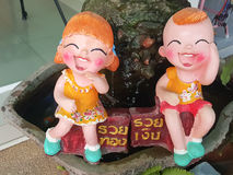 Close up,Happy dolls for garden decoration havegreeting in Thai Stock Photos