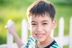 Close up happy face of boy outdoor in the sunset time black and white Royalty Free Stock Image