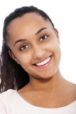 Close up Happy Face of a Young Asian Indian Girl. Close up Portrait of a Happy Pretty Face of a Young Asian Indian Girl Looking at the Camera on White Background Royalty Free Stock Photo