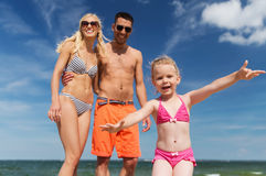 Close up of happy family with child on beach Royalty Free Stock Photography