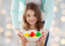 Close up of happy family holding easter eggs Stock Photography