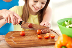 Close up of happy family making dinner in kitchen Stock Images