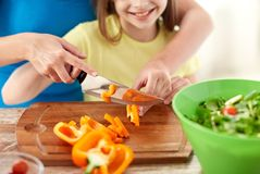 Close up of happy family making dinner in kitchen Royalty Free Stock Photography