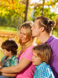 Close-up of happy family sitting together in hug Royalty Free Stock Images