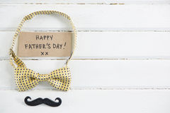 Close up of happy fathers day text with bow tie and mustache royalty free stock images