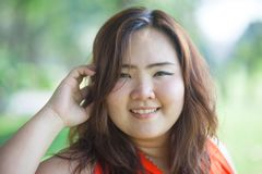Close up of happy fatty woman. Close up of happy fatty asian woman outdoor in a park Stock Photo
