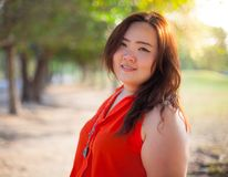 Close up of happy fatty woman. Close up of happy fatty asian woman outdoor in a park Royalty Free Stock Photo