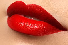 Close-up happy female smile with healthy white teeth, bright red lips make-up. Cosmetology, dentistry and beauty care. Macro of woman`s smiling mouth Royalty Free Stock Photo