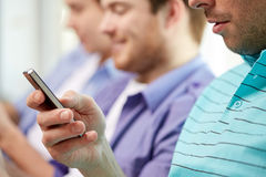 Close up of happy friends with smartphones at home Stock Photo