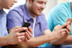 Close up of happy friends with smartphones at home Royalty Free Stock Photography