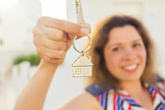 Close-up of happy house owner or renter showing keys and looking at you. Happy house owner or renter showing keys and looking at you Royalty Free Stock Photo