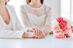 Close up of happy lesbian couple with flowers Stock Photos