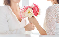 Close up of happy lesbian couple with flowers Royalty Free Stock Photos