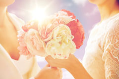Close up of happy lesbian couple with flowers Royalty Free Stock Image