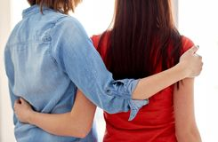 Close up of happy lesbian couple hugging at home Royalty Free Stock Image
