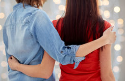 Close up of happy lesbian couple hugging at home Royalty Free Stock Photos