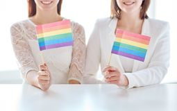 Close up of happy lesbian couple with rainbow flag Stock Photo