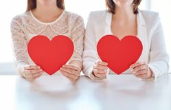 Close up of happy lesbian couple with red hearts Royalty Free Stock Photos
