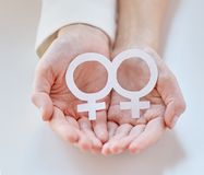Close up of happy lesbian couple with venus symbol Royalty Free Stock Image