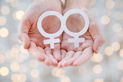 Close up of happy lesbian couple with venus symbol Royalty Free Stock Images