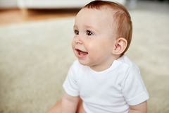 Close up of happy little baby boy or girl at home Royalty Free Stock Photos