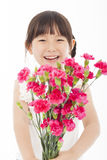 Close up of happy little girl holding  a bouquet of carnations Stock Image