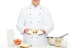 Close up of happy male chef cook baking dessert Stock Images