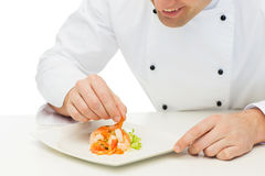 Close up of happy male chef cook decorating dish Stock Photography
