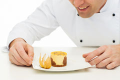 Close up of happy male chef cook with dessert Royalty Free Stock Images