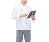 Close up of happy male chef cook holding tablet pc Royalty Free Stock Images