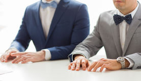 Close up of happy male gay couple hands on wedding Royalty Free Stock Image
