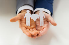 Close up of happy male gay couple with love symbol. People, homosexuality, same-sex marriage and love concept - close up of happy male gay couple holding paper royalty free stock photo